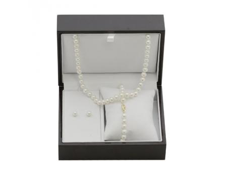 14K Yellow Gold Freshwater Pearl Set - 6-6.5mm freshwater cultured pearls with 14k gold clasps. Meet our number one best selling set!!! That's right this classic freshwater cultured pearl set nicely finished in a rich wooden box is our top must have item. Not only is this the essential classic cultured pearl set for a woman to purchase for her self but at this price it is also the perfect set for her to buy as a gift for her daughter, grand daughter or any young lady in her family for that matter. Now imagine a man walking into your store… he has no idea what to buy as a gift for his wife or girlfriend, he sees this beautiful cultured pearl set already finished with in the beautiful keep sake box! SOLDThe market for this set reaches every demographic making this our top recommendation for 2013. Make sure that you have plenty of stock because you will be seeing a huge return on this investment!
