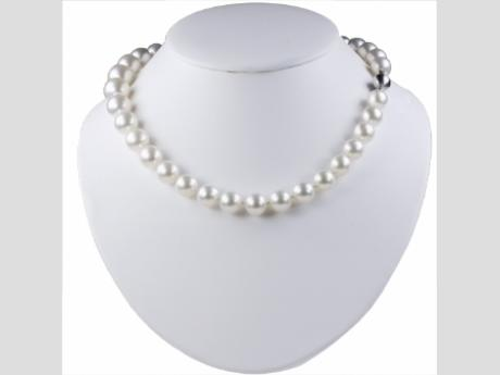 11-14mm White South Sea cultured pearl NecklaceThe epitome of luxury. This south sea cultured pearl necklace has a satin like luxurious glow, beautiful luster, and round cultured pearls with a very nice surface quality. The clasp is made of 14k gold. If you are looking for a necklace that represents a life full of accomplishment, high class, and sophisticated taste you may have just found the perfect piece.