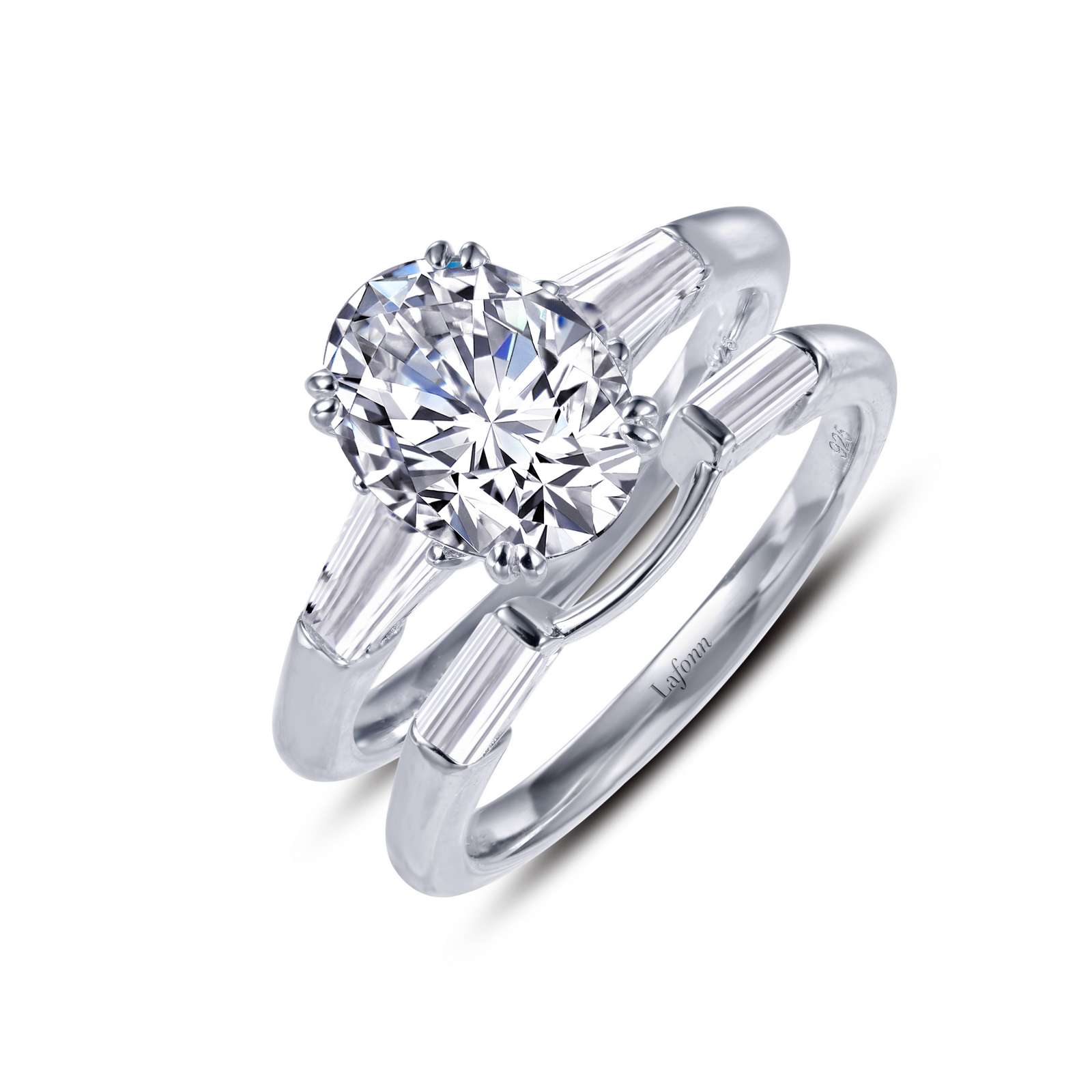 Classic Simulated Diamond Platinum Ring - A classic engagement ring with matching band. The stunning engagement ring features an oval Lafonn Lassaire simulated diamond in the center with a single tapered baguette on each side. This wedding set is set in sterling silver bonded with platinum.