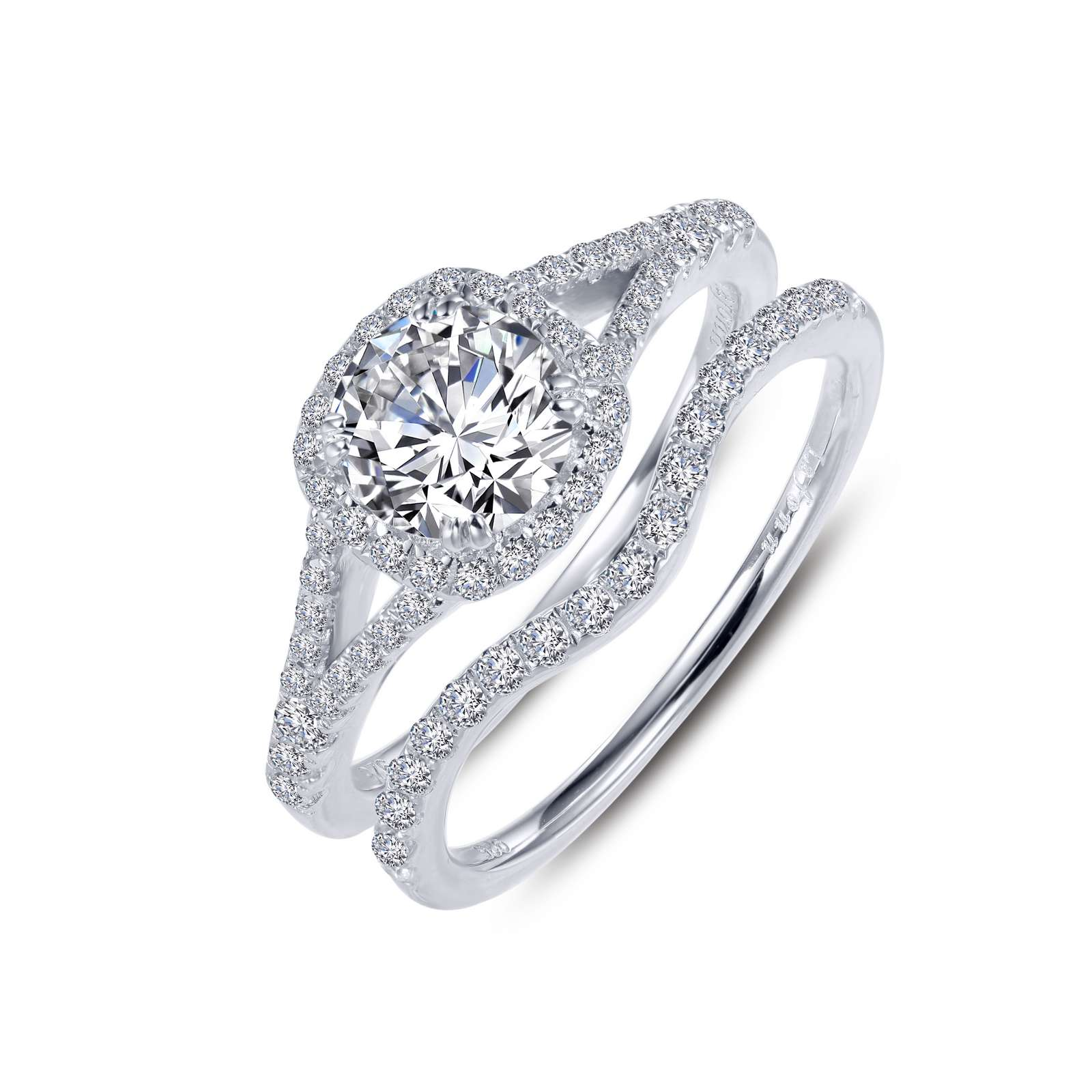 Classic Simulated Diamond Platinum Ring - This classic split shank halo engagement ring showcases a round Lassaire simulated diamond center stone. Additional round Lassaire simulated diamonds line the band and the matching wedding band. This wedding set is set in sterling silver bonded with platinum.