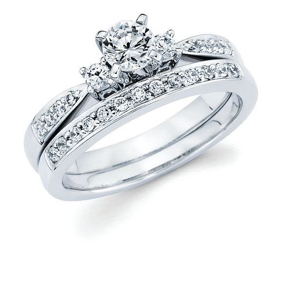 14k White Gold Engagement Set - 3 Stone Bridal: 1/5 Ctw. Diamond Semi Mount shown with 1/3 Ct. Round Center Diamond in 14K Gold 1/8 Ctw. Diamond Wedding Band in 14K Gold Items also available to purchase separately