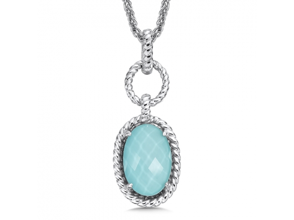 Colore SG  Sterling silver, and turquoise fusion pendant - Eye catching and elegant drop pendant of sterling silver set with a 15 X 10 mm oval shaped luxurious turquoise fusion stone. A unique, signature piece to elevate any style. Chain included.