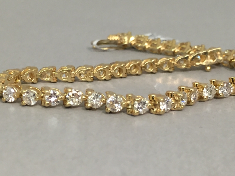 Diamond Bracelet - 14k yellow gold 5.00ct tw diamond tennis bracelet, 41 diamonds, 7 inches long