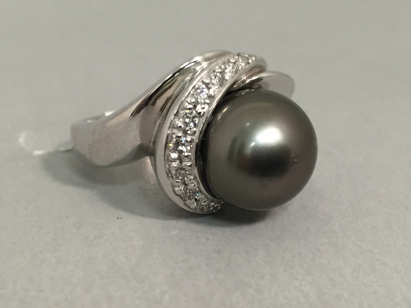 Pearl and Diamond Ring - 14k white gold cultured pearl and diamond ring. .20ct total weight.
