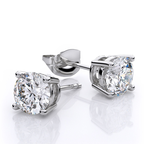 Diamond Solitaire Earrings - 14k white gold 1/6ct total weight diamond solitaire earrings bezel set.