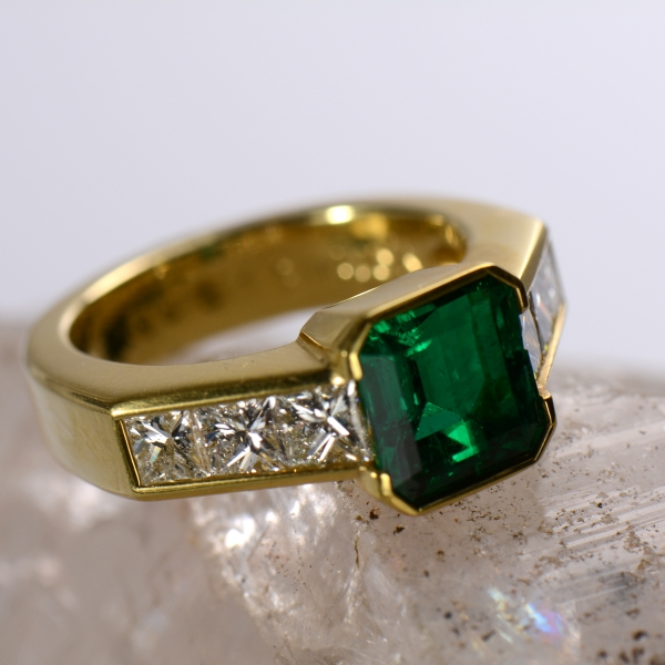 Ladies Emerald Ring - Ladies 18k yellow gold Emerald and Diamond ring.  This ring features a 1.86ct actual weight emerald, with even, intense, dark, very slightly bluish green color with excellent clarity.  Each shoulder of the ring is channel set with three diamonds equaling 1.24 ct total weight.