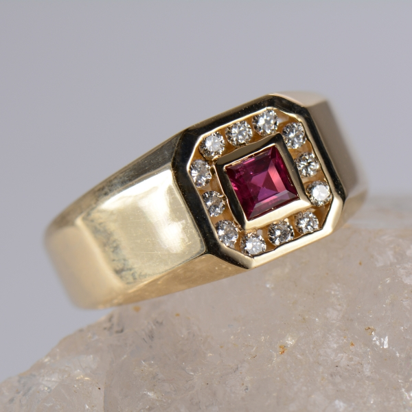 Gents Ruby Ring - Gents 14k yellow gold 4 m/m ruby and 1/4ct total weight of diamond ring..