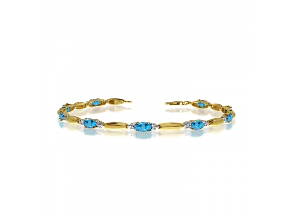 14K Yellow Gold Oval Blue Topaz and Diamond Bracelet by Color Merchants